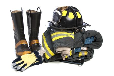 ヘビーデューティ保護消火布、ブーツ、手袋、ヘルメット、ジャケット、ズボン、白い背景で隔離 写真素材