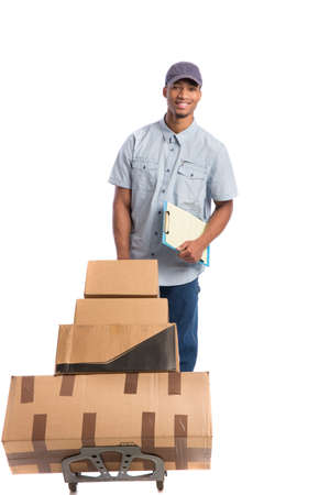 african business man: Young African American Man Delivery Boxes on isolated white background Stock Photo
