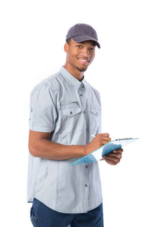 Young African American Service Man Writing on Clipboard  isolated white background photo