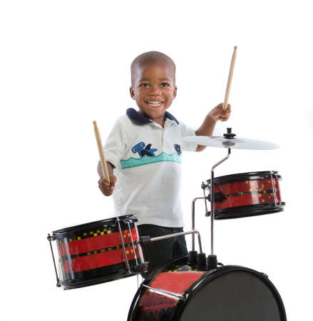 Three Year Old African American Boy Playing Drum Set Isolated on White Background photo