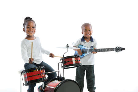 children at play: African American Brother and Sister Playing Music Instrument Set Isolated on White Background Stock Photo