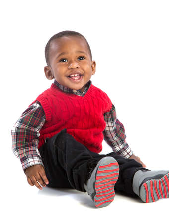 One Year Old Adorable African American Boy Sitting Smiling on Isolated White Background photo