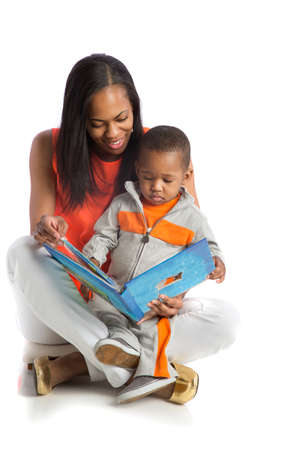 Smiling African American Mother and Baby Boy Reading Book Together on Isolated White background photo