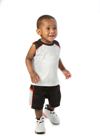 sports wear: One Year Old Adorable African American Boy Standing Portrait Wearing Sports Wear on Isolated White Background