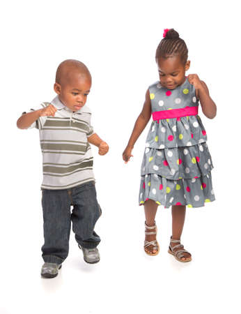 Smiling Young African American Brother and Sister Portrait Isolated on White Background Dancing Together photo