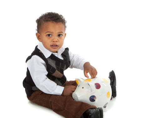 One Year Old African American Baby Boy Playing Piggy Bank Isolated photo