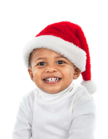 sweet tooth: Adorable African American Boy Wearing Christmas Santa Hat Laughing on White Stock Photo