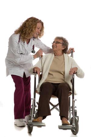 Home Care Nurse Push Senior on Wheelchair on Isolated White Background photo