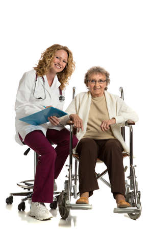 Home Care Nurse Checking with Senior on Wheelchair on Isolated White Background photo