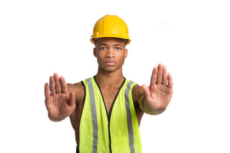 hard worker: Natural Looking Worried Young African American Construction Worker Gesture NO on Isolated Background