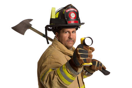 volunteer point: Serious looking confident firefighter standing holding ax and flash light portrait isolated on white background