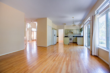 newly remodeled finished kitchen with oak cabinet and floor empty photo