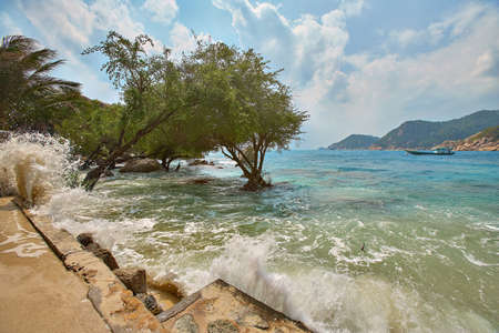 The waves beat on the shore of the island Thailand