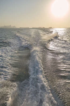 astern: Boat wake, trail in sea after fast moving boat.