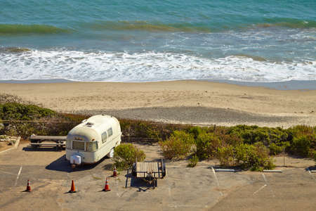 depraved: Vintage american mobile home on a camping site on the malibu beach
