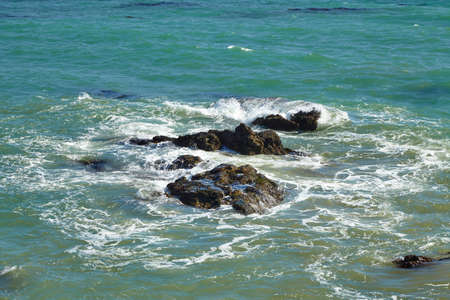 beating: Waves beating against coastal rocks on the cliffs in Malibu California