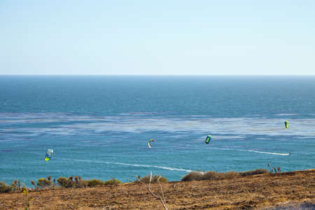 choppy: Kitesurfing on a very choppy sea in Southern California Malibu Stock Photo