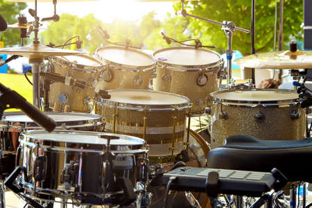Acoustic drum set on stage before the concert.