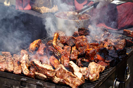 reno: BBQ Grilled pork ribs on the grill. Stock Photo