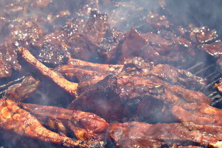 pork ribs: BBQ Grilled pork ribs on the grill. Stock Photo