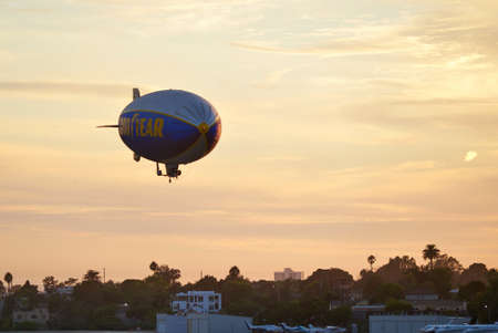 blimp: SANTA MONICA, CALIFORNIA USA - OCT 07, 2016: The Good Year blimp Zeppelin, Spirit of Goodyear with yellow stripe , flies over Santa Monica airport, USA. Rides aboard the Goodyear Blimp are by invitation only.