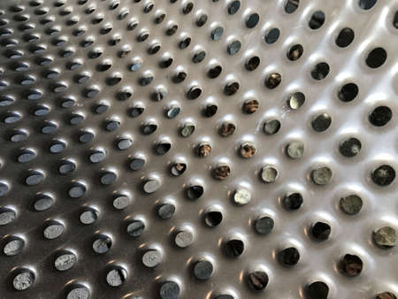 Steel plates with holes for texture. Background. Stock Photo