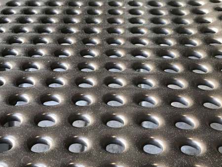 grille: Steel plates with holes for texture. Background. Stock Photo