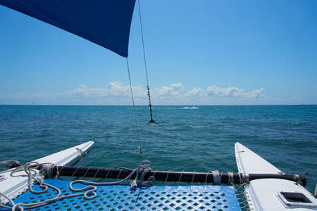 Sailing yacht catamaran sails on the waves in the warm Caribbean Sea. Sailboat. Sailing. Cancun Mexico. Summer sunny day, blue sky with clouds. Imagens
