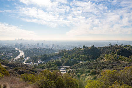 View of Los Angeles from the Hollywood Hills. Down Town LA. Hollywood Bowl. Warm sunny day. Beautiful clouds in blue sky. 101 freeway traffic.