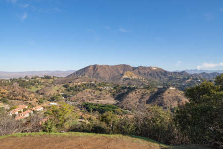View of Hollywood Sign from Hollywood Hills. Warm sunny day. Beautiful clouds in blue sky. Imagens