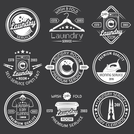 Laundry room and dry cleaning service set of vector white emblems, labels and badges with washing machine, hanger, clothes basket, clothespin, isolated on dark background