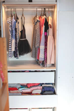 Vertical storage of clothing. childrens room. Clothing folded for vertical storage in the linen drawer. Nursery. Sliding wardrobe. Room interior. Neatly folded clothes in chest of drawers.