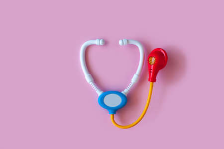 Doctors medical tools on a pink background. Concept. View from above. Stock Photo