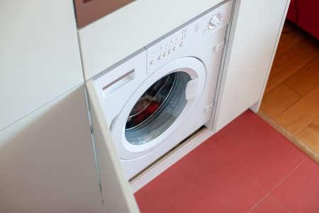 White washing machine at home. Modern interior. Home organizing. Imagens