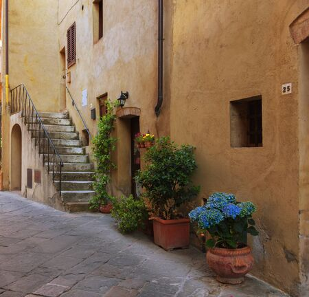 Traditional facade of Italian house in the small magical and old village of Pienza, Val D'Orcia Tuscany, Italy