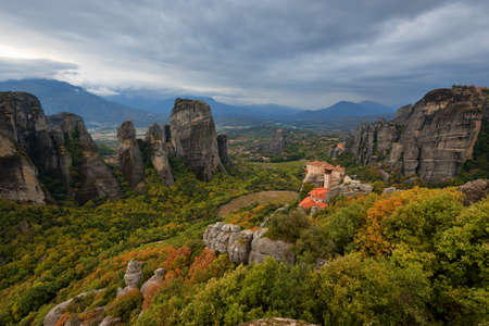 Magnificent autumn landscape.The Monastery of Rousanou or St. Barbara Monastery and the Monastery of St. Nicholas at Meteora. 免版税图像