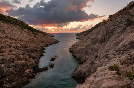Landscape view of rocky formations Korakonisi in Zakynthos, Greece.Beautiful summer sunset, magnificent seascape.