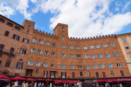 SIENA, ITALY MAY 25, 2017: Piazza del Campo.The historic centre of Siena has been declared by UNESCO a World Heritage Site. Beautiful historic buildings and palaces.