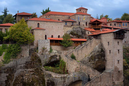 Great Meteoron Monastery. Beautiful scenic view, ancient traditional greek building on the top of huge stone pillar in Meteora, Eastern Orthodox Church, Pindos, Thessaly, Greece, Europe 新闻类图片