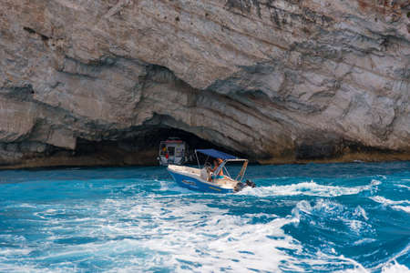 ZAKYNTHOS, GREECE, September 27, 2017: Blue Caves and blue water of Ionian sea on Island Zakynthos in Greece and sightseeing points. Rocks in clear blue sea