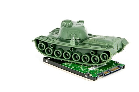 hard drive: toy tank crushes hard drive Stock Photo