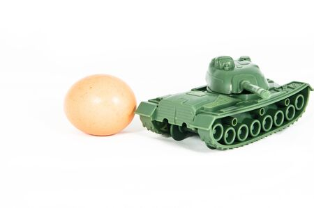 protects: toy tank protects egg Stock Photo