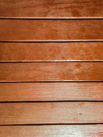 surface: Brown wood texture.