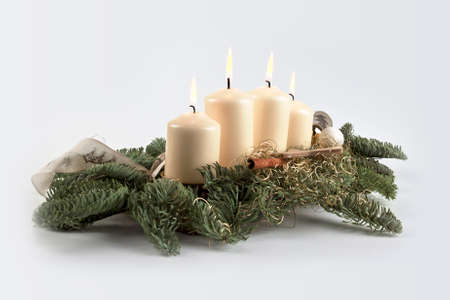 Christmas candles arrangement with pine branch photo