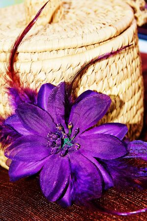 Natural rattan basket with one purple flower Stock Photo
