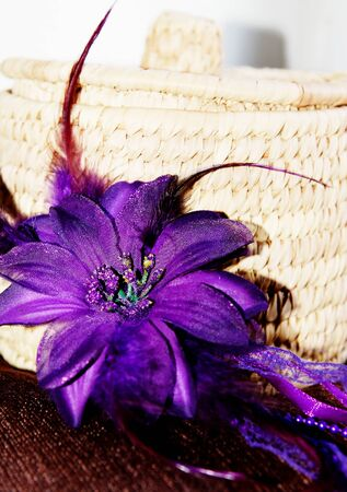 Natural rattan basket with purple flower