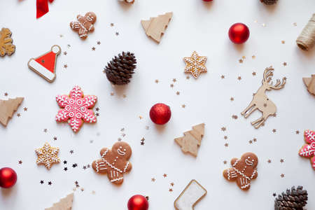 Christmas and New Years eco decorations and homemade gingerbreads on a white background. Perfect festive backdrop for your Christmas Card. Flatlay style.