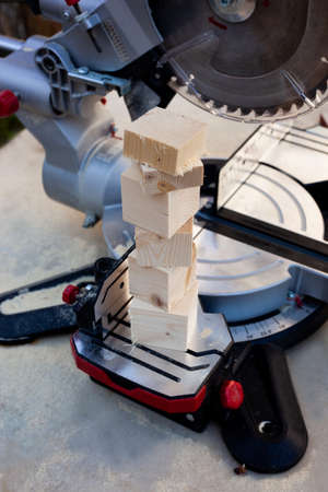 Electric tool with circular metal blade for woodworking. Process of sawing a pine wood.