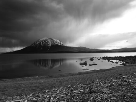 aproaching storm on mountain and lake Stock fotó