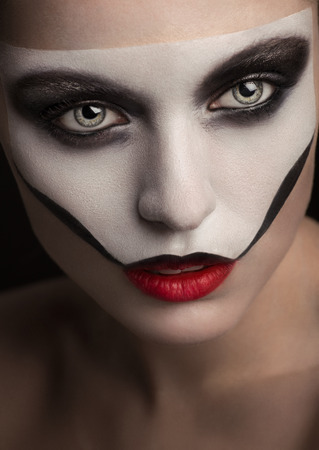 Makeup with painted skull mask photo